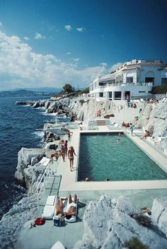Guests by the pool at the Hotel du Cap Eden-Roc, Antibes, France, August (Photo by Slim Aarons/Hulton Archive/Getty Images)Image provided by Get. Slim Aarons, Vacation Destinations, Dream Vacations, Vacation Travel, Cruise Vacation, Air Travel, Golf Travel, Shopping Travel, Cheap Travel
