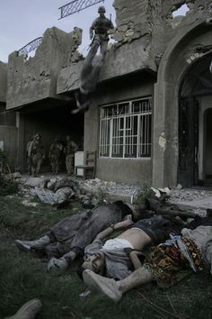 "Iraq, Baghdad. November 17, 2004. After the offensive on November 8, Marine units take up positions in the northeast of Fallujah. Insurgent groups were still fighting against US forces, who had the task of ""cleaning"" the city house by house"
