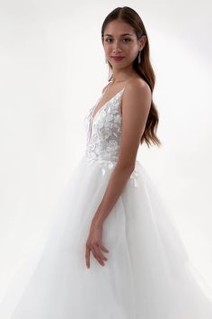 With enchanting appliques and a tiered tulle skirt for added volume, the Natalie is straight out of a fairytale, just like your love story!