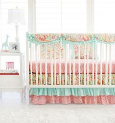 Sweet Pink & Aqua Paisley Baby Girl Bedding. The adorable ruffle crib skirt and ruffled crib rail cover bring charm to your little girl's nursery. Coral, Aqua, and Floral crib bedding set.