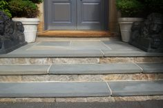 Steps with reclaimed stone veneer and Pennsylvania bluestone treads.