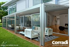 Aluminium pergola with retractable roof. This is no ordinary patio awning. The retractable roof is motor-driven and controlled by means of a wall switch, or remote control. Typical Italian - superior design and engineering.
