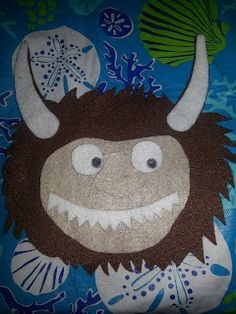 Simple to make out of felt, could totally make it out of foam too.  Children At Play: Where The Wild Things Are Felt Board