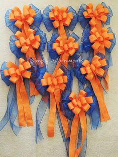 Orange and royal blue wedding pew bows.