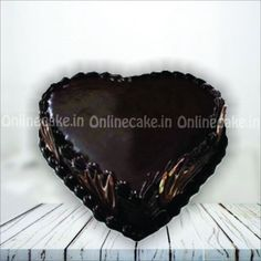 This heart shaped chocolate cake is very famous among couples. Enriched with chocolate in a hear shaped soft and fluffy sponge of cake, this can be the best at all times and any time. Tasty Chocolate Cake, Dark Chocolate Cakes, Chocolate Hearts, Chocolate Flavors, Fresh Cake, Online Cake Delivery, Heart Shaped Chocolate, New Year's Cake, Heart Shaped Cakes