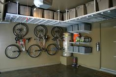 Garage ceiling storage ideas are simple yet creative solutions to maximize space availability. Overhead storage in garage options are shown here Garage Ceiling Storage, Overhead Garage Storage, Garage Storage Solutions, Diy Garage Storage, Storage Hacks, Pallet Storage, Outdoor Storage, Ceiling Shelves, Craft Storage