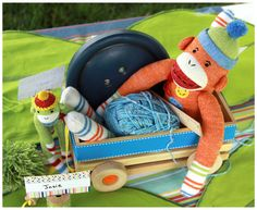 sock monkey in wood crate wagon