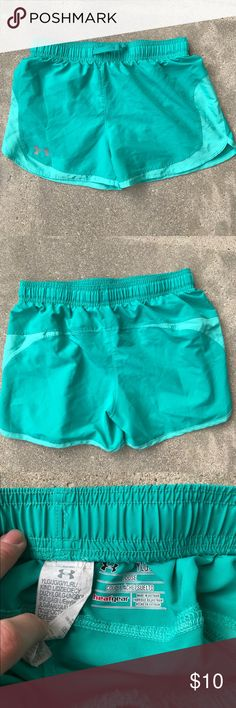 Under Armour Teal Youth Large Running Shorts Under Armour Teal Youth Large Running Shorts - could also fit women's size XS- great condition Under Armour Bottoms Shorts