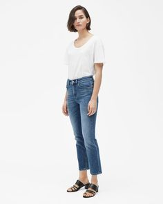 Cropped, straight-leg jeans with a slightly higher waist and slim hip, made from mid blue comfort stretch denim. Style with a crisp white tank top, Tee or shirt casually tucked in for a fresh spring look. Slim Hips, Stella Jean, Spring Looks, White Tank, Stretch Denim, Blue Denim, Mom Jeans, Normcore, Tank Tops
