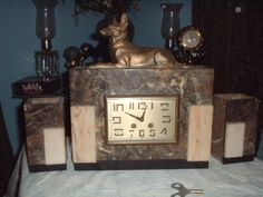 Art Deco Nefer-Temu Pharaoh Hound Clock and Garnitures case with Henri Japy Freres Movement, 1920-25 | Collectors Weekly