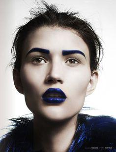 Blue eyebrows blue lips