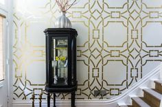 Metallic bronze elegant stairway and hallway for home decor using Royal Design Studio Contempo Trellis Modern Wall Stencil Pattern - painted on walls by Caroline Lizarraga Decorative Artist