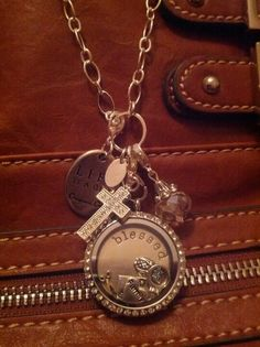 My origami owl locket tells my story... what's yours? https://www.facebook.com/pages/Origami-Owl-Ashley-Burd-Independent-Designer/527508530603205