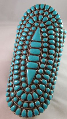Vintage Zuni sterling silver and turquoise cluster  cuff bracelet made by Lillian Preston of Tuba City, Arizona in the 1980's.