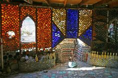 A beautiful structure made from colorful bottles.