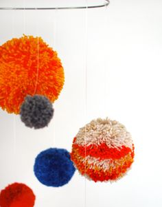 Pom Pom planets woollen craft project.