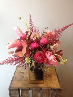 This elegant arrangement overflows with burgundy, plum, and magenta. The rich colors and unique flowers draw you in and make your heart yearn for more.  $75.00