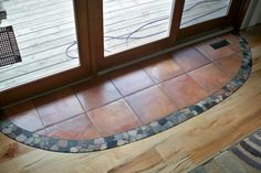Hardwood floor with tile inlay for under dinning room table. Hmmm ... maybe with red brick instead of neutral tiles