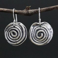 These organic Spiral earrings embody the universal positve symbol that represents life itself. Created by metal smith and jewelry designer Sherry Tinsman whose work is 100% handcrafted in her beautiful solar powered Bucks County studio. Comes in gift box.