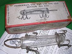 Detroit Glass Minnow Tube These well-made, heavy glass lures were marketed around 1914 with the idea that a single minnow could live inside the Detroit Glass Minnow Tube all day and catch fish after fish. These valuable lures had German silver fittings. Imagine casting one onto rip-rap or rocks! The lure cost over a dollar in an era when many people barely earned that much in half a day.