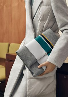 All in the details. Smooth leather stripes define new-season accessories