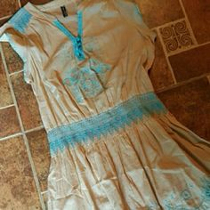 Beautiful Free People dress This dress is so cute with the turquoise embroidery on peach cotton. Elastic low waist. Madewell Dresses