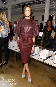 Allison Williams showed off fall's hottest hue- Oxblood on a peplum trimmed leather skirt at Peter Som New York Fashion Week 2013.