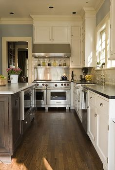 """Love the blue color with the white trim.   48"""" wolf range and hood located near corner of kitchen."""