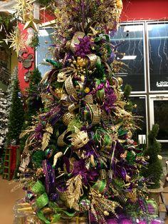 Mardi Gras Christmas Tree designed by Arcadia Floral & Home Decor.