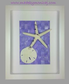8x10 Shadow box frame.  Starfish and sand dollar displayed on a woven hand painted paper background.