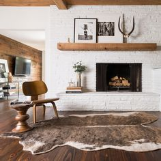 If your fireplace is in desperate need of a new appearance, you've come to the correct place! Because of this, seeing a brick fireplace is rather common, but there's more than 1 style. White brick fireplace employs unused bricks to… Continue Reading → Living Room Decor, Living Spaces, Cow Hide Rug Living Room, Living Rooms, Living Area, Kitchen Living, Living Room Brick Wall, Apartment Living, Brick Bedroom
