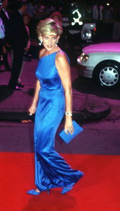 Princess Diana wore this gorgeous blue Versace gown in 1996, a year before her friend, designer Gianni Versace was murdered. Versace also designed a famous short-sleeve pink suit with pillbox hat (very Jackie O) for the princess and named a purse -- the Lady Di -- after the princess.