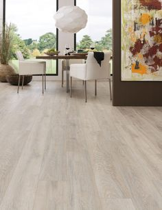 Laminate Flooring - I like the greyish shade... It needs to look a little more seamless though.