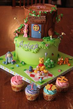 Winnie the Pooh and friends cake with matching cuppies by Andrea's SweetCakes, via Flickr ( I absolutely LOVE that Tigger is looking at the little lady bug on the side of the cake!!!)