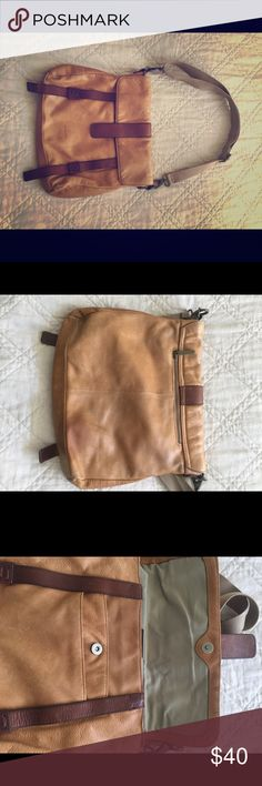 Cynthia Rowley Leather Messenger Bag Tan with dark brown leather trim. Adjustable fabric strap.  Interior pockets are lined with tan fabric. No stains/rips or odors. Zippered pocket on back of bag. Good used condition. No trades. Cynthia Rowley Bags Crossbody Bags