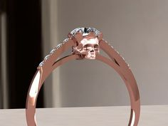 Rose gold skull engagement ring by adamfosterjewelry on Etsy