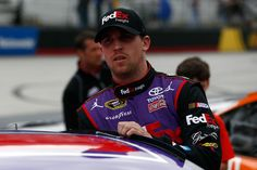 Denny Hamlin, driver of the #11 FedEx Freight Toyota, climbs in his car prior to the start of the NASCAR Sprint Cup Series Food City 500 at Bristol Motor Speedway on April 19, 2015 in Bristol, Tennessee.