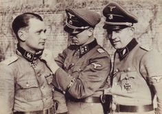 """Kurt Meyer rewarding Hermann Weiser Knight's Cross fordecisive leadership which led to the capture of the Russian forces defending the town of Valki. On the right,medical director of SS Division """"Leibstandarte Adolf Hitler"""" Hermann Besuden."""