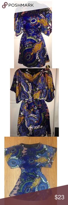 """BcbgMaxazria women's kimono dress XS/S Gorgeous Bcbgmaxazria women's kimono dress. Color as shown on photo. Size tag says XS but can fit both XS/S since it ties at the waist . Perfect for the summer season. Has a zipper back closure. Dimensions are chest 32-34"""",waist 26-27"""" length from shoulder down is 34.5"""" 96% polyester,4% spandex BCBGMaxAzria Dresses"""