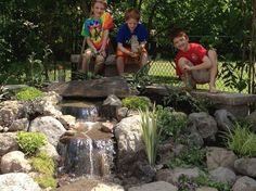 landscape design waterfalls water feature paver patio sitting wall with pillars, outdoor living, patio, ponds water features, The entire family even the kids can now enjoy their new Outdoor Room in Brighton NY by Acorn Landscaping of Rochester NY