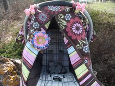 Girl car seat Canopy.Reversable  Infant Carseat Cover /Carseat Tent .Nursing Cover.Snaps for Safe and Easy Opening and Closing FREE Shipping. $38.99, via Etsy.