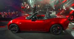 Hmmm....having a bit of trouble seeing #DuranDuran frontman Simon Le Bon cruisin' the streets in a #Mazda #Miata, but heck they still put on a good show right?  Here's the link to see the band playing for the all-new #MX5 #Miata launch event, enjoy! http://youtu.be/Ze5GPxABcMs