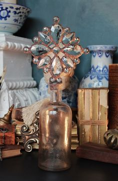 Cross Bottle Guy, altered bottles, clear, hazy, bottle, cross bottles, shell topped bottle, crossbottleguy, cross bottle, luxury home decor, religious art, handmade art, crystal, antique, vintage, rosary, french, aqua, blue, green