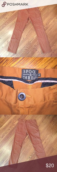 Spool and Thread Khaki Pants This is a pair of men's size 33 Spool and Thread khaki pants. These pants are slim towards the ankle, and fit well around the waist. They are 98% cotton and 2% spandex. They are a burnt orange or copper color. Spool and Thread  Pants Chinos & Khakis
