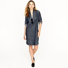 this tunic is crafted from raw cotton denim and boasts workwear-inspired touches like roll-up sleeves (that button to stay in place) and gusset-reinforced hems