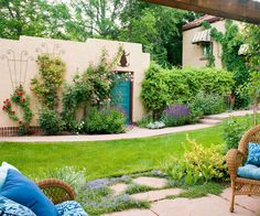 Create a Canvas-Understated walls are perfect for showcasing art. So use neutral green, gray, or brown backgrounds to highlight plants or colors in your yard. Here, for example, a beige stucco wall makes beautiful climbing roses and honeysuckle shine. (climbing rose is a must in my garden)