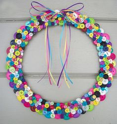 Do this in green for St Patty's Day!  Wreath is made from wood round.    Unique Button and Bow Wreath. $45.00, via Etsy.