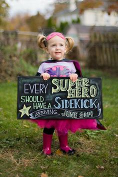 super cute pregnancy announcement! Taken by Leandra Green Kenny.