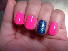 Hot pink nails with blue glitter