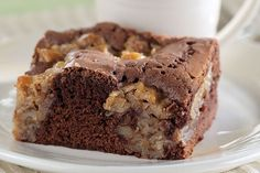Try this tasty German chocolate cake with coconuts and pecans. Our easy chocolate cake recipe is an absolute cinch: it starts with a brownie mix!